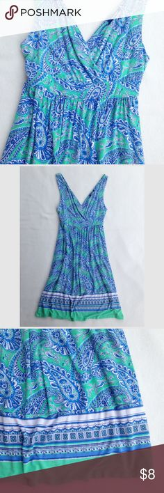 """Old Navy Paisley Sundress or Swim Coverup Old Navy sundress or swim cover up. Green and blue floral paisley design.  Very stretchy and soft t-shirt fabric. Top bodice is double layer, front and back. Used it still in great condition - no spots or obvious signs of wear. Flat lay measurements: 38"""" length, 25"""" length waist to hem, 12 1/2"""" waist unstretched. Old Navy Dresses"""