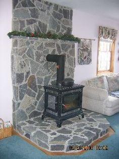 wood stove and field stone Wood Stove Wall, Corner Wood Stove, Wood Stove Surround, Wood Stove Hearth, Wood Burner Stove, Wood Burner Fireplace, Stone Fireplace Wall, Pellet Stove, Fireplace Hearth