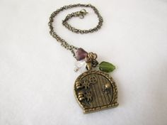 Hobbit hole door necklace by ReadingFanGirl on Etsy