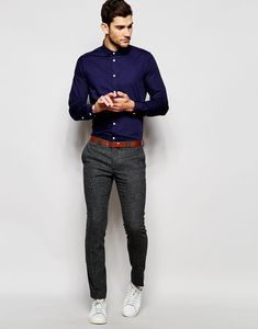 Nail that dapper look with a navy oxford shirt and dark grey trousers. White low top sneakers will contrast beautifully against the rest of the look.   Shop this look on Lookastic: https://lookastic.com/men/looks/navy-dress-shirt-charcoal-dress-pants-white-low-top-sneakers/20798   — Navy Dress Shirt  — Tobacco Leather Belt  — Charcoal Dress Pants  — White Low Top Sneakers