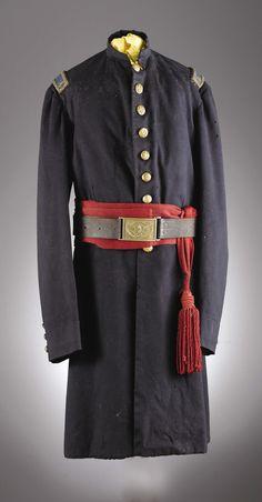Union Infantry Officer's Nine-Button Frock Coat with 1st lieutenant shoulder straps, crimson sash, belt, and buckle.