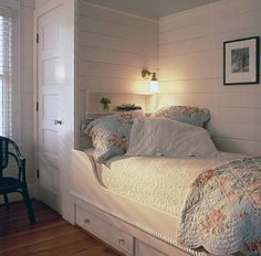 Really short on space?  Twin bed with closet wall for a headboard & storage under the bed...great solution.