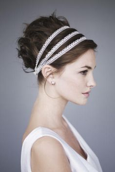 pretty disheveled updo with lace ribbon used as headbands.