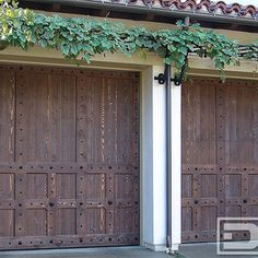 Spanish Garage Doors, Custom Designed & Handcrafted by Dynamic Garage Door of CA - Our Spanish Garage Doors are custom designed to reflect the architectural past of the colonial architecture found in Spain. Spanish Garage Doors are specifically stained by hand in a rich stain color that enhances the natural look of, in this case, the solid cedar wood. Nature's wooden grain is uniquely beautiful which accentuates the rustic look of our Spanish Garage Doors. As the wood wood ages through ...