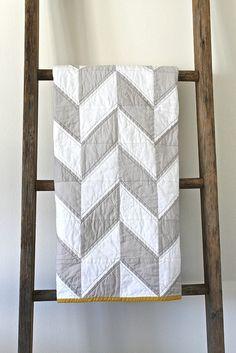 Grey Chevron patterned quilt via The New Victorian Ruralist