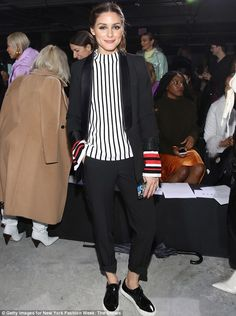 Style icon: The 31-year-old style icon wore a black and white vertically striped top