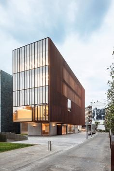 Architect Javier de las Heras Solé has completed a music school building in Spain, featuring a concrete podium and facades clad in weathering-steel mesh that allows partial views of the interior. Building A Porch, School Building, Contemporary Architecture, Architecture Design, Parametric Architecture, Technical Architect, Spanish Towns, Floor Sitting, Weathering Steel
