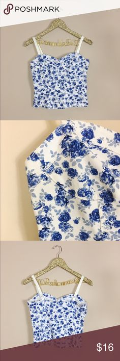 """H&M Cropped Bustier Blue Floral Top H&M Cropped Bustier Blue Floral Top. So cute & perfect for summer! Adjustable straps. Some slight marks on adjustable straps but in great condition. Size M. Length 18"""", arm to arm flat lay across chest 15"""". No modeling/trades. H&M Tops Crop Tops"""
