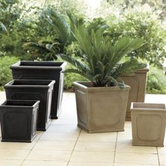 The Chapelle Square Planters are a perfect home for your favorite plants, and will add life to any front porch.