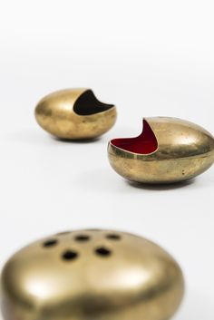 Anonymous; Brass and Enamel Ashtrays and Cigarette Holder by Cohr, 1950s.
