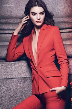 Kendall Jenner in a red tuxedo blazer and matching trousers