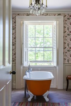 """Spot Cole & Son's Hummingbirds wallpaper in this beautiful bathroom. """"We always meant to change the colour of the bath but somehow it works with the rest of the room."""" 