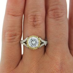 a beautiful yellow gold and white gold diamond engagement ring with a diamond halo