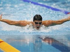 Dana Vollmer of the U.S. swims to a world record in the women's 100m butterfly, winning gold