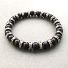 ◊ Men's stylish stretch beaded bracelet handmade with a mixture of 8mm black acrylic pearl beads and 9mm metal washer beads. ◊ The bracelet is stretchy