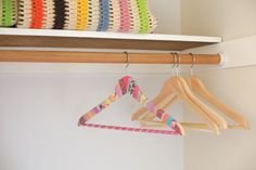 Goodbye plain, plastic hangers! We've already got the washi tape out to try this.