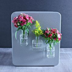 Make these fun little magnetic fridge vases made with upcycled nail polish bottles!