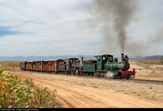 No.7 and No. 95 Sandstone Estates Steam 4-4-0 at Free State, South Africa by RailRog. Double headed Lawley locomotives bring a passenger train into Hoekfontein. These miniature sized locomotives were first used on the 100 mile long 2 foot gauge railway that ran inland from Beira (Mozambique) to Umtali (Rhodesia, now Zimbabwe) that was built in 1898. They were nicknamed 'Lawleys' after Mr Lawley, the construction and operations manager on the railway at that time.