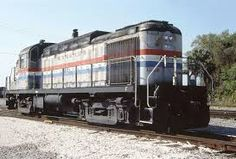 (RS-3M).  Amtrak  #106. A diesel-electric locomotive rebuilt from an ALCO RS-3 road switcher  and repowered with a EMD 567 engine and longer hood.