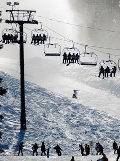 The ski lifts are full on opening day at Brighton Ski Resort on Nov. 13. (Trent Nelson     The Salt Lake Tribune)