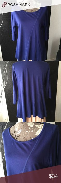 Eileen Fisher blue shirt Sz m NWOT Eileen Fisher Women's Blue high low shirt (sides are long) Sz medium . Please refer to pics for true detail description of the condition and please message me if you have any questions thank you and happy shopping! Eileen Fisher Tops Tees - Short Sleeve