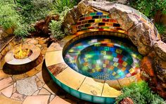 Rainbow Spa. The sun shines through a dome of translucent colored #tiles creating a stunning rainbow in the spa below. The fire pit adds drama and warmth during cool evenings. The fiber optic #lighting that rings the base of the #spa cycles through a palette of colors creating a unique artistic setting.