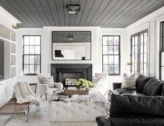 grey ceilings make this black an white living room cozy   house tour via coco kelley