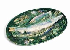 A LARGE FRENCH (ALFRED RENOLEAU) MAJOLICA PALISSY-STYLE OVAL DISH -   INCISED SIGNATURE RENOLEAU AND DATE 1929 -   Modelled with an eel, a pike, and a trout, a crayfish, a frog and shells  27 in. (68.5 cm.) wide
