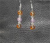 Brown translucent glass beads and pink acrylic beads. Silver spacers and fish hook earrings. Price: $6.00