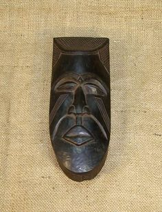 African Boxes and masks of the Kuba. This African Box from the Kuba tribe of the Democratic Republic of Congo measures 11.75 inches long and 3 inches tall and is hand-carved of wood. This example of Kuba art is an antique and is believed to be over 70 years old.