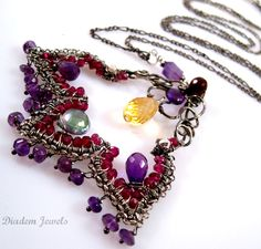 An abstract lotus flower made from sterling silver wire, garnet, amethyst, mystic topaz, and golden citrine stones. Oxidized Sterling Silver, Sterling Silver Chains, Lotus Necklace, Mystic Topaz, Wire Wrapped Jewelry, Handmade Jewelry, Handmade Items, Amethyst, Jewelry Making