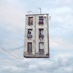 """Flying Houses by Laurent Chéhère - """"I tried to get these sad houses out of the anonymity of the street, to help them to tell their story, true or fantasised,"""" said Chéhère."""