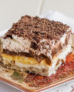   With a pecan crust, a layer of sweetened whipped cream cheese, a layer of chocolate pudding, another layer of vanilla pudding and topped off with whipped cream and grated chocolate!!