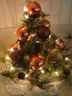 Cupcake stand Christmas tree...how simple is this? For Fall or Christmas with different colored balls.