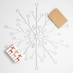 Whether you hang or lean it on a wall, our festive snowflake-shaped cardholder gives your season's greetings the display they deserve.