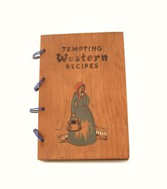 Vintage Cookbook of Tempting Western Recipes with wood cover.