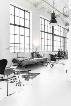 A total #black & #white #industrial #loft in Eindhoven captured by @paulinaarcklin