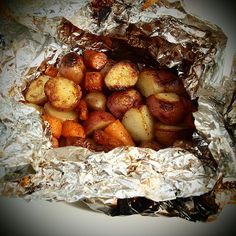 Perfect potato packets: baby red potatoes, washed and cut into bite size pieces carrots, washed and cut into bite size pieces 2 Tbsp olive oil salt fresh ground black pepper: Place potatoes and carrots on foil, wrap into packets with some olive oil, salt, pepper, close tightly Place packet on grill, turning every 5 minutes or so until vegetables are done (about 30 minutes)