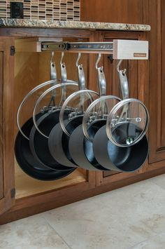 Www.Glideware.com  Great way to organize your pots, pans and lids. Cookware storage! Lid storage!