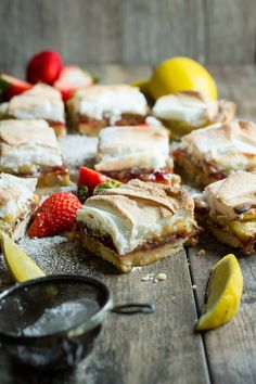 These strawberry lemon meringue bars will get you ready for summer cook outs and lazy picnics.
