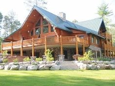Massive luxurious log home with access to Big Sandy Lake.
