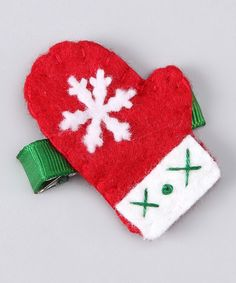 Do ---  Take a look at this Red Snowflake Mitten Hair Clip on zulily today!