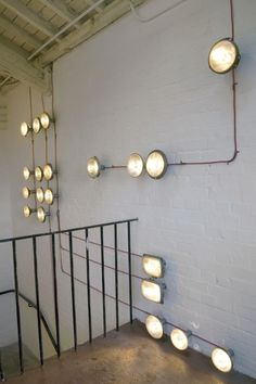 Do these lights look familiar? They're made from recycled car headlights! Reuse of an abundant material and design flexibility to create any configuration make this a modern, green idea. This designer used incandescent bulbs and red fabric electric cord which also infuses the space with color.