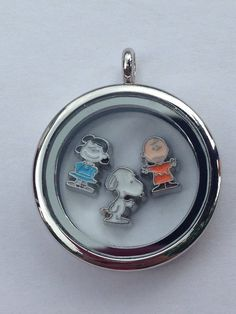 Peanuts Characters Floating Charm Locket-Charlie Brown, Snoopy, and Lucy on Etsy, $20.00