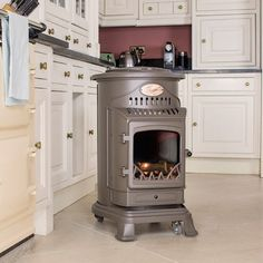 The rustic of the complements any setting whilst offering you a very economic Ideal for or The stylish gas stove Provence is available in 5 colours: matt gloss black, dark honey glow and Stove Heater, Pellet Stove, Gas Stove, Portable Gas Heaters, Portable Stove, Fireplace Backsplash, Chimney Cowls, Character Cottages, Outdoor Stove