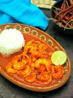 Camarones a la Diabla 4 to 6 roma tomatoes Dried chiles de arbol 2 dried guajillo chilies 1 tablespoon butter 1 tablespoon olive oil 1/2 medium onion, thinly sliced 1 clove garlic, minced 1 lb. shrimp, deveined