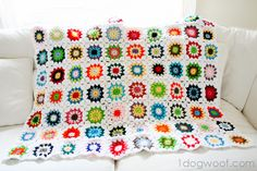 One Dog Woof: Colorful Squares Crochet Quilt free pattern by Yvonne from Yvestown - http://www.redheart.com/free-patterns/copenhagen-pillow
