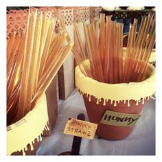 Honey straws in tissue paper lined and die-cut trimmed terra cotta pots. Winnie the Pooh Birthday Party. By Big Moosie Studio.