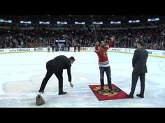 UFC fighter CM Punk shot the puck during the second intermission of Monday's game.