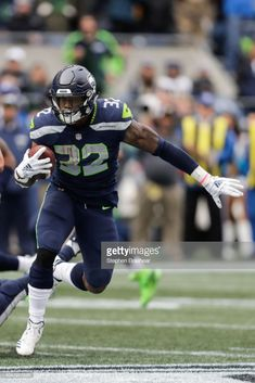 Running back Chris Carson of the Seattle Seahawks runs the ball in the second half against the Los Angeles Rams at CenturyLink Field on October 2018 in Seattle, Washington. Get premium, high resolution news photos at Getty Images Nfl Seattle, Seattle Seahawks, Seahawks Football, Football Players, Nfc West, Nfl Carolina Panthers, Running Back, Nfl Sports, World Of Sports